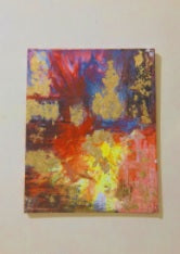 A multi colored yellow blue and red abstract painting