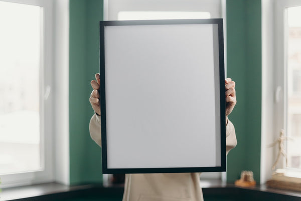 A person holding a black and white board