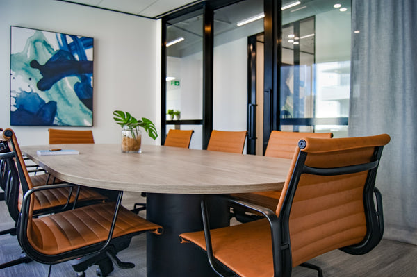 A photo of a brown wooden 9 piece office table and chairs