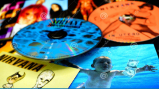 A photo of a cd artwork of the nirvana group album
