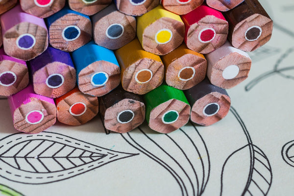 A photo of a coloring book and coloring materials