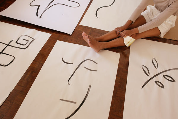 A photo of a cropped woman and abstract illustrations on the floor