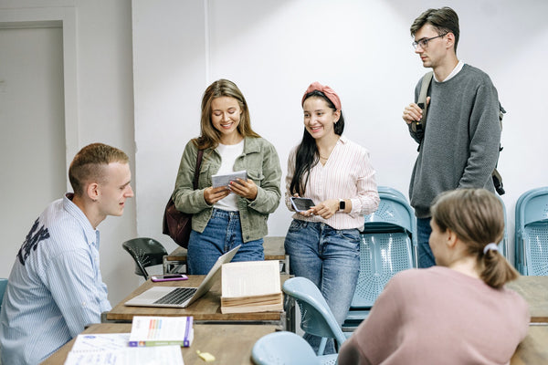 A photo of a group of people studying together