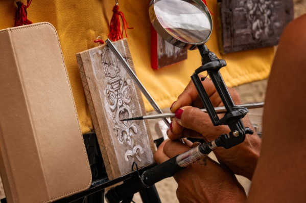 A photo of a person doing a craft to art design