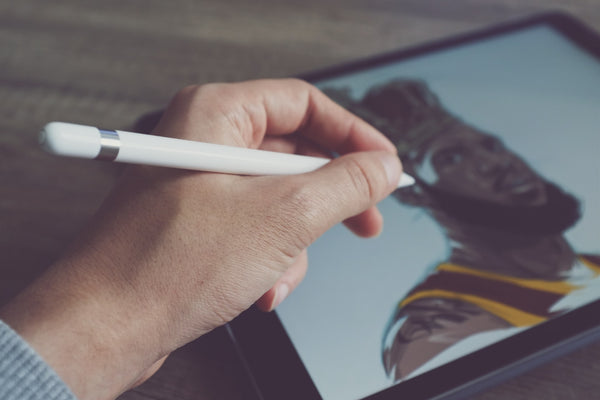 A photo of a person drawing LeBron James on an android tab