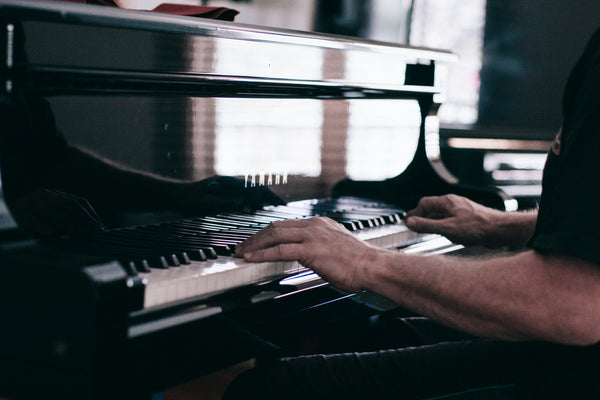 A photo of a person playing a piano
