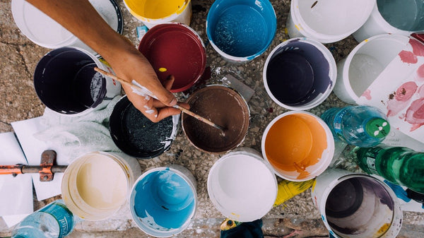 A photo of different buckets of colored paints