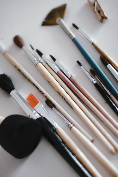 A photo of makeup brushes on a white table