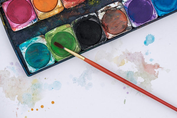A photo of water color in a paint box used for dye