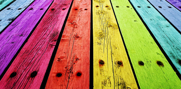 A photo showing various colors of bottom wooden boards