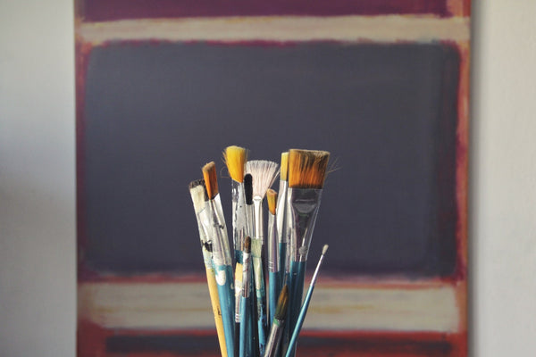 A set of blue paint brushes