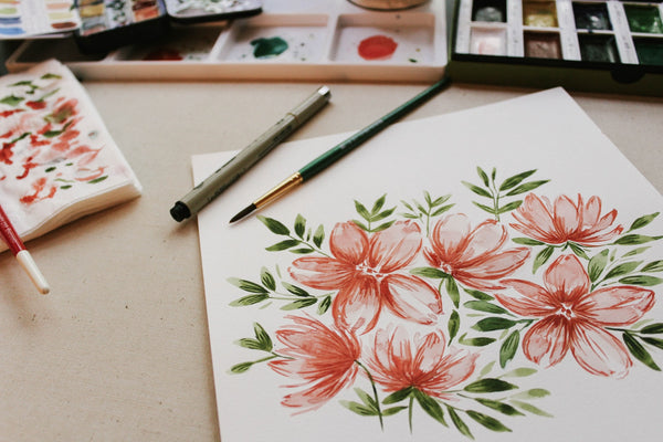 A water color painting of flowers on white paper