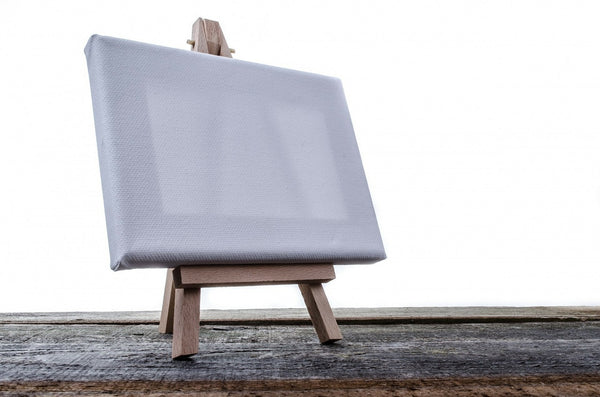 An isolated canvas mounted on a wooden stand