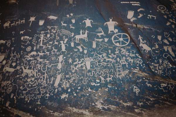 Painting on shabby rock wall