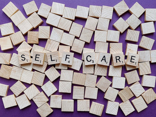 Scrabble game with the letters spelling self care