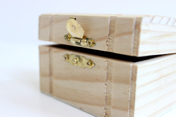 A wooden box used to organize jewelry