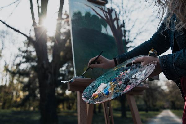 An artist finishing her painting
