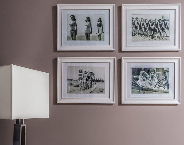 A collection of framed photos on a wall