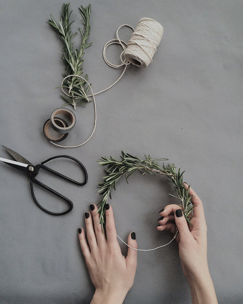 A DIY wreath being made on a table