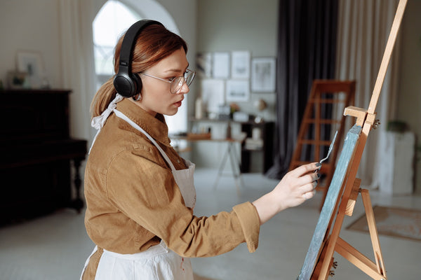 Lady painting her canvas with music