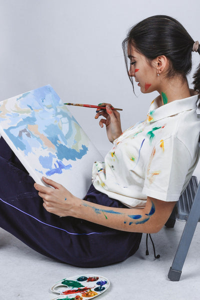 Lady relaxing while painting
