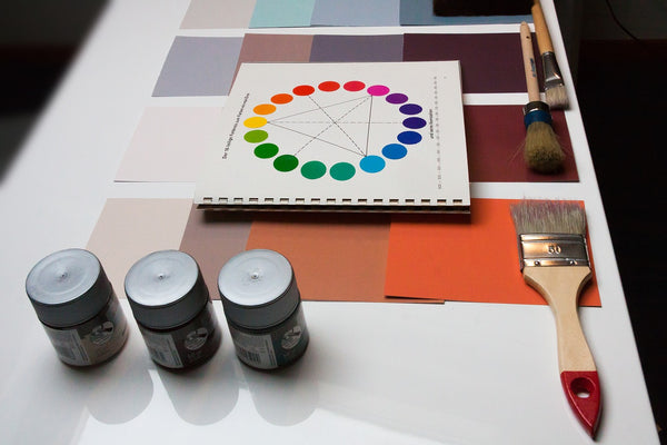 Painting materials laid out on a table