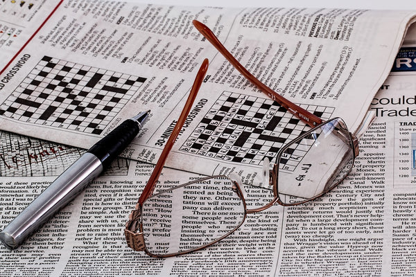 Newspaper with crossword puzzles
