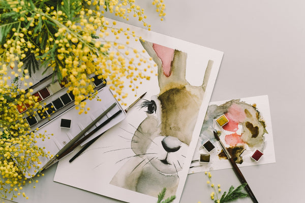 painting of a bunny beside yellow flowers