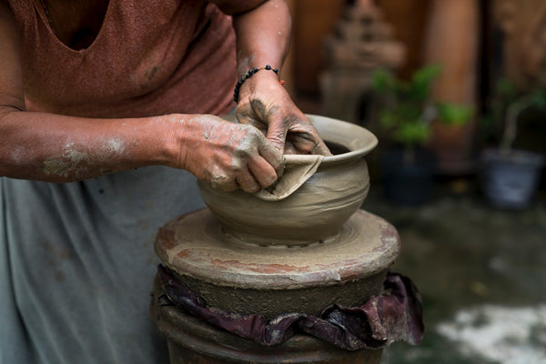 A clay pot being crafted
