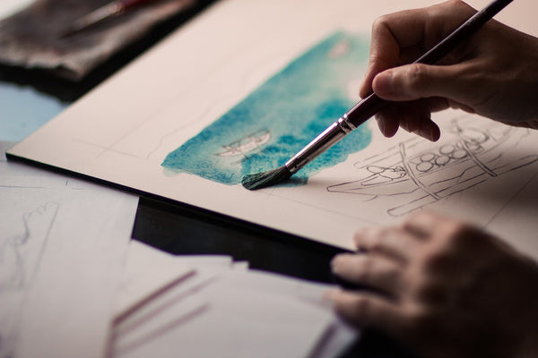 A person painting with watercolors