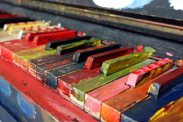 A piano of many different colors