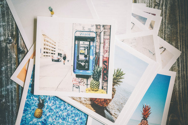 A pile of assorted old photos