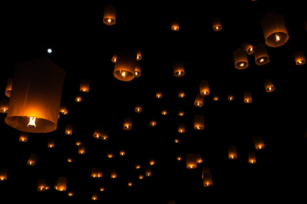 A plethora of floating candles in the sky