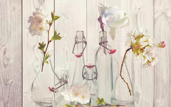 A wall being beautified by vases with flowers in them