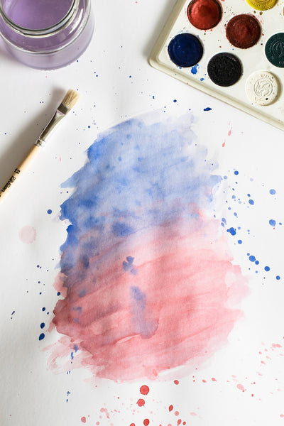 A watercolor painting being created
