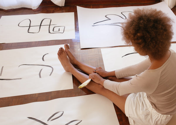 Woman looking at drawings on the floor