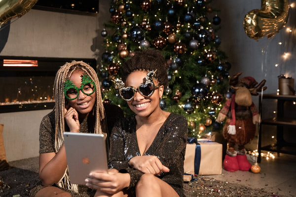 Women in sunglasses during Christmas