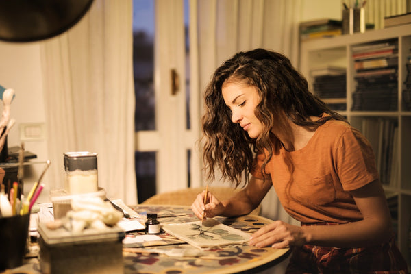 A young lady painting her canvas