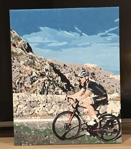 A person with helmet on a bike riding through the mountains on the street. The picture was painted with a custom paint by number kit.