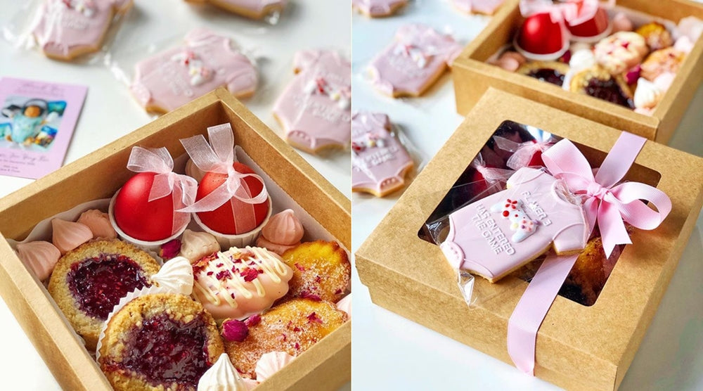 Baby girl full moon gift box filled with pink-coloured desserts