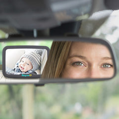 mom viewing baby with baby car mirror