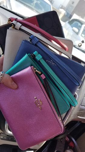 Loaded coach wristlets