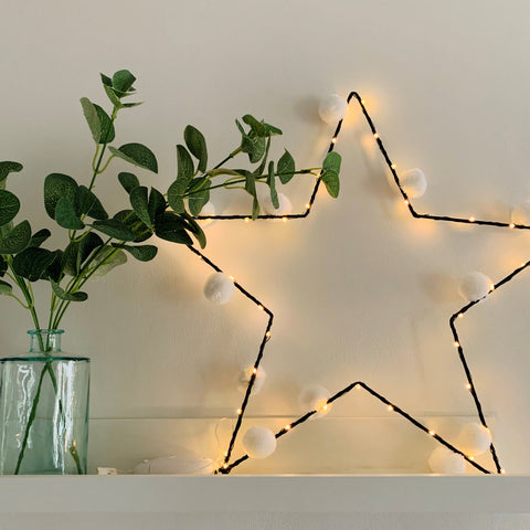 Star Light with white pom pom's