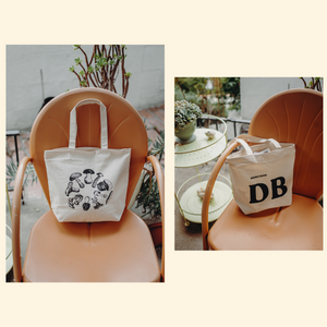 DoubleBlind: DoubleBlind Tote bag on a chair.