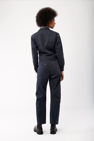 The Only Jane Jump One in Stone. Back shot with grey turtleneck sweater and boots