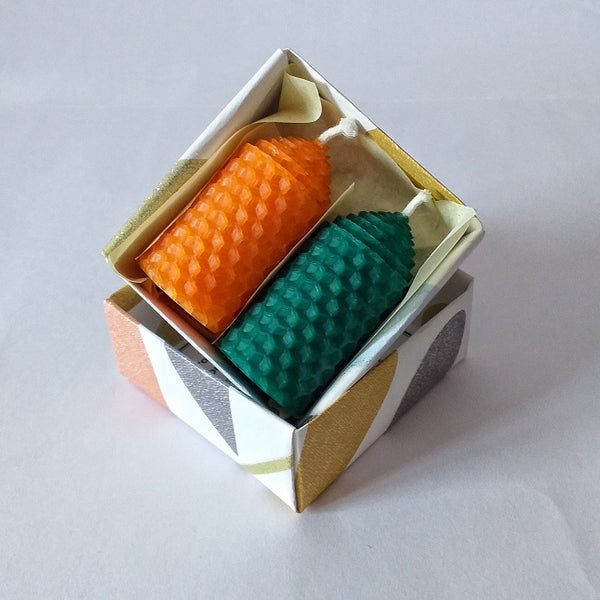 Orange and green pure beeswax candles in a giftbox