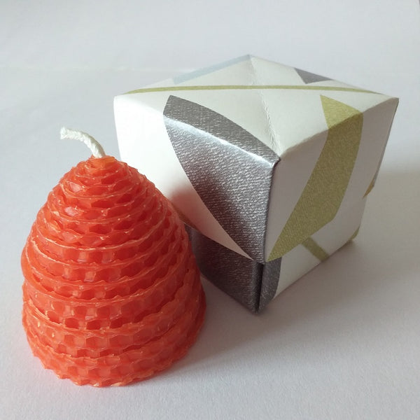 Small orange beehive beeswax candle in handmade giftbox