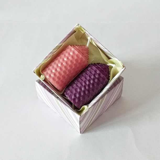 Pink and purple handmade pure beeswax candles in a giftbox