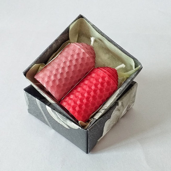 Handmade pink and red pure beeswax candles in a giftbox