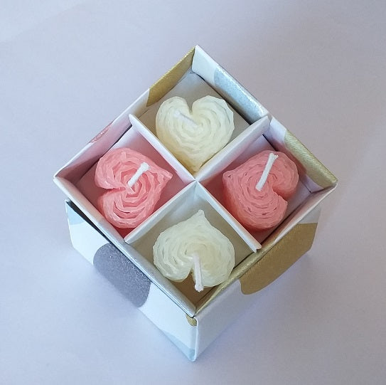 Pink and white heartshaped beeswax candles